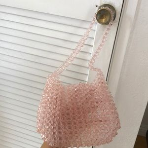 Urban Outfitters beaded pink purse.